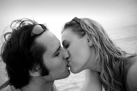Man kissing a woman on the beach Stock Photo - 6400077
