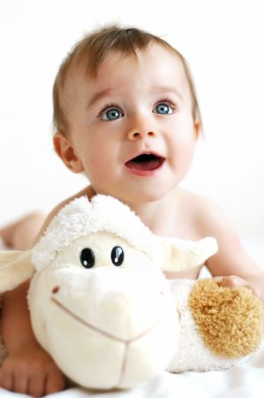 Little boy playing with a lamb Stock Photo