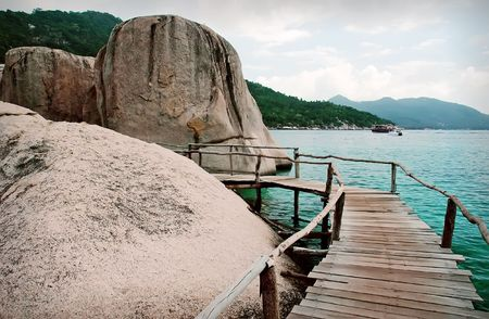 Wooden footbridge to the island of Koh Nangyuan, Thailand photo