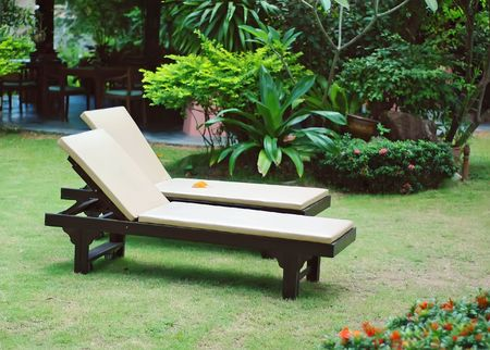 Two sun beds in the garden . Stock Photo