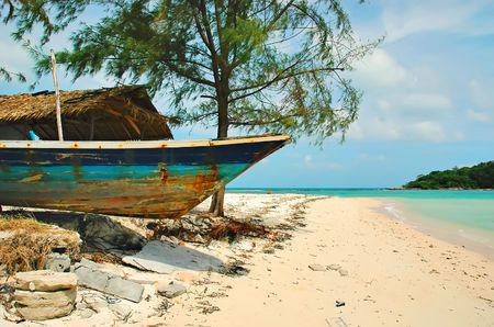 Chaweng beach and old wooden boat, Thailand photo