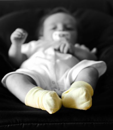 Detail of childrens feet with yellow socks photo