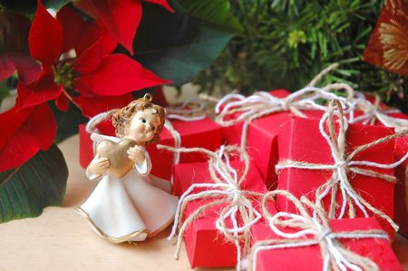 Poinsettia, angel and small Christmas gifts photo