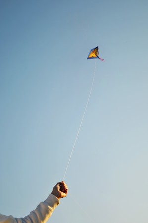 The Flying color kite and hand photo