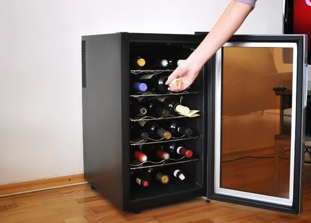 Wine cellar with wine botltes photo