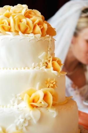 Wedding cake with orange marzipan roses - shallow dof