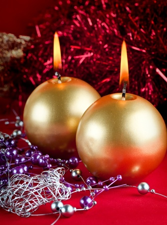 Two golden candles - christmas still life . photo