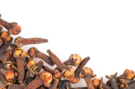 The background - aromatic spices cloves . photo