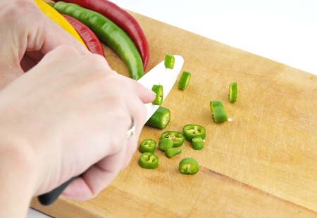 The details - a woman chopping chillies photo