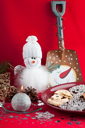 The white snowman on a red background . Stock Photo - 11707932