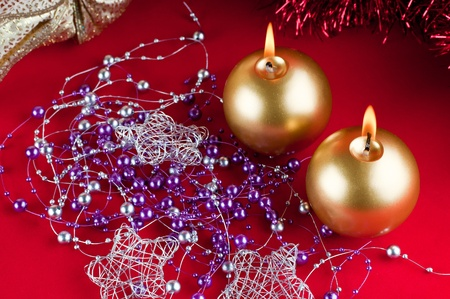 Two golden candles - christmas still life . Stock Photo - 11707947