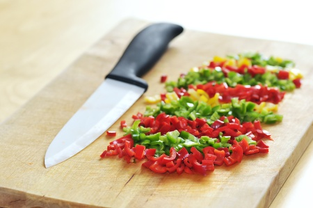 The ceramic knife and chopped chillies photo