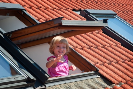 sunroof: The little girl in the roof window .