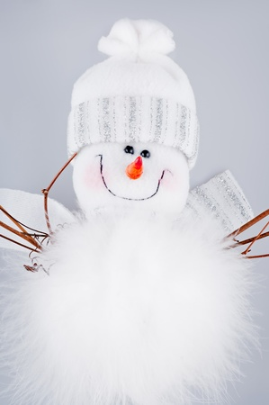 The white snowman on a white background . photo