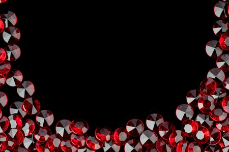 The red crystal on a black background . photo