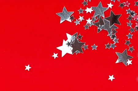 The silver stars on the red background . photo