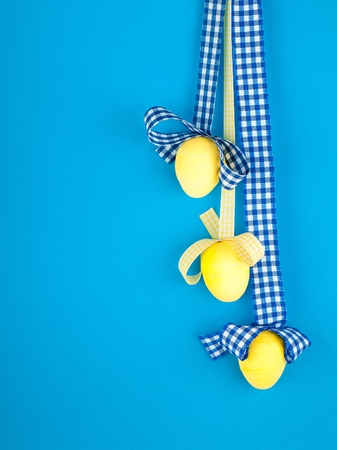 The three yellow eggs with checked ribbon photo