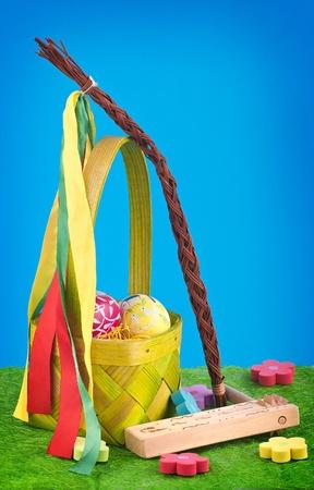 ratchet: Easter decoration - basket, eggs, ratchet, flower, whip Stock Photo