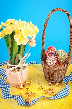 Easter still life - daffodils, eggs, ribbon  photo