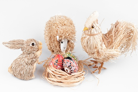 The rabbit, cock, sheep and nest with eggs . photo