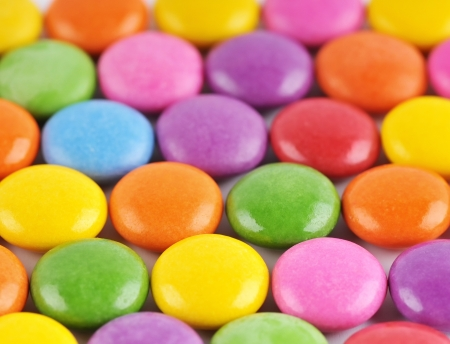 The colors of chocolate candies - background photo