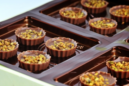 The Nougat pralines with pistachio nuts . photo