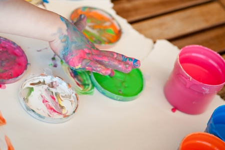 Little girl painting colors on hand Stock Photo