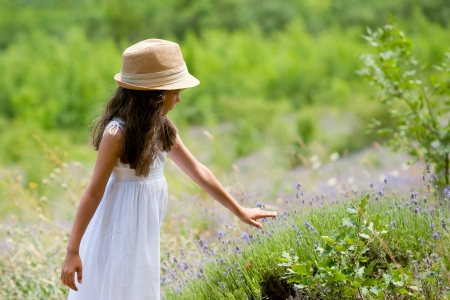 the sincerity: Adorable little girl in a lavender field