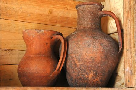 Old clay wine jugs in a traditional Adega wine cellar in the Azores