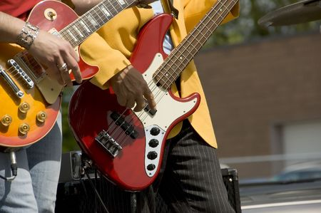 Two guitarists at an outdoor gig Stock Photo