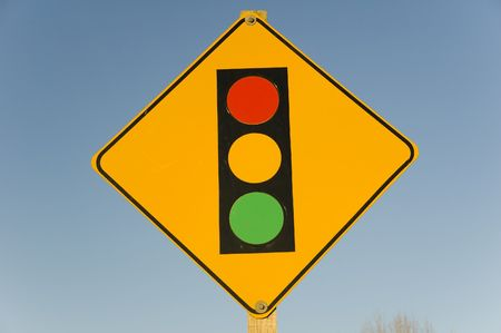 This image shows a vibrante sign that warns cars of oncoming traffic lights photo
