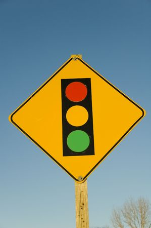 This image shows a vibrante sign that warns cars of oncoming traffic lights Stock Photo - 788361