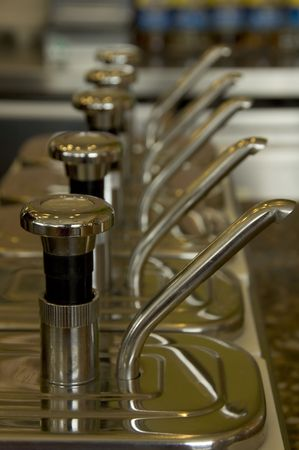 Syrup Dispensers lined up at a trendy coffee shop Stock Photo
