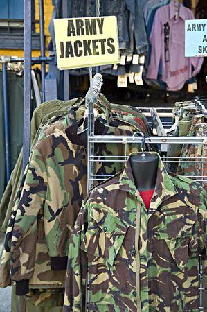 Army jackets on a rack at Kensington Market