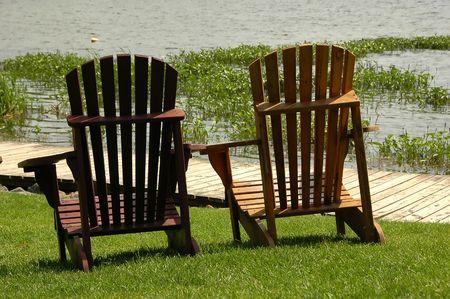 Muskoka chairs by the lake photo