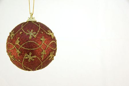A single red christmas ball ornament on white