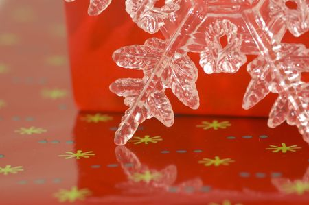 Glass start leaning against a red wrapped gift