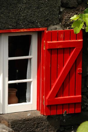 Wood shutter on a traditional house in the Azores