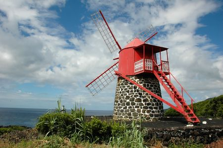 Old windmill in the Azores against the sky