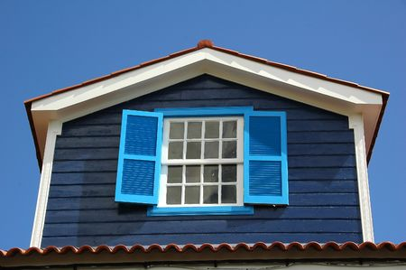 Wood windows on an old azores home Stock Photo