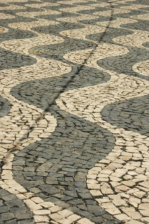 Curvy black and white Cobblestone pathway on an Island in the Azores