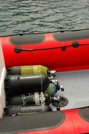 Oxygen tanks on a boat before going out for a dive Stock Photo