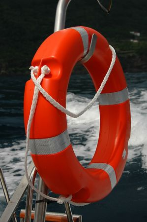 red buoy with ropes attached to the side of a boat Stock Photo