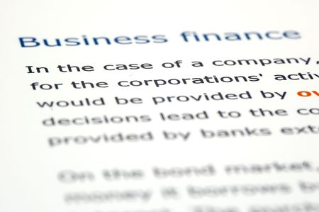Macro shots of financial news and documentation focusing on key titles Imagens