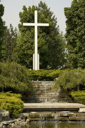 Cemetery pond with water feature and Cross