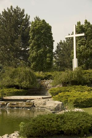 water feature: Cemetery pond with water feature and Cross