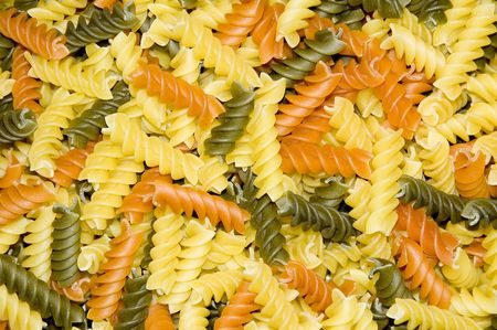 Top view of colorful twisted pasta pieces Stock Photo