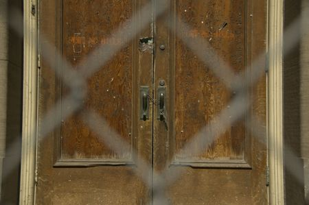 Old door behind chainlink fence Stock Photo - 834113