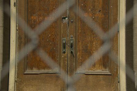 Old door behind chainlink fence