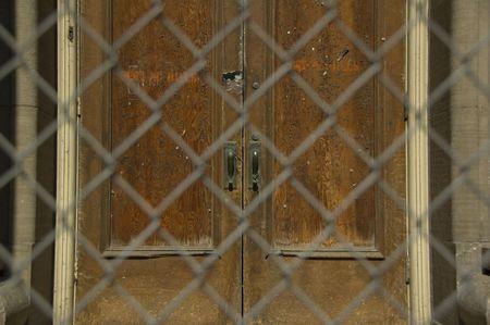 Old door behind chainlink fence Stock Photo - 834111